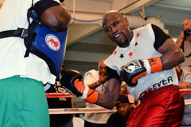 LAS VEGAS, NV - APRIL 22: Boxer Floyd Mayweather Jr. works out with his co-trainer Nate Jones at the Mayweather Boxing Club on April 22, 2014 in Las Vegas, Nevada. Mayweather will face Marcos Maidana in a 12-round world championship unification bout in Las Vegas on May 3. (Photo by Ethan Miller/Getty Images)