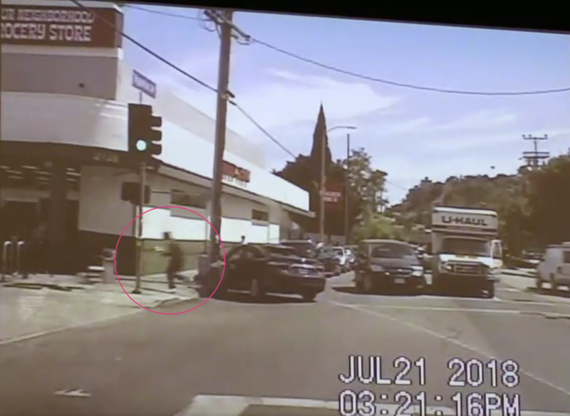 Video released by police appears to show suspected gunman Gene Atkins, 28, entering the Trader Joe's store after abandoning his car during a police chase. (LAPD)