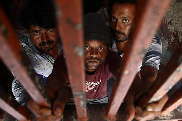 <p>Indian fishermen stand behind bars after being arrested by the Pakistani authorities, in Karachi, Pakistan, May 4, 2017. (Photo: Shahzaib Akber/EPA) </p>