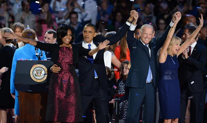 (L-R) US First Lady Michelle Obama, US President Barack Obama, US Vice President Joe Biden and his wife Jill Biden celebrate on election night November 7, 2012 in Chicago, Illinois. Obama and Biden won re-election to a second 4-year term.    AFP PHOTO / Saul LOEB        (Photo credit should read SAUL LOEB/AFP/Getty Images)