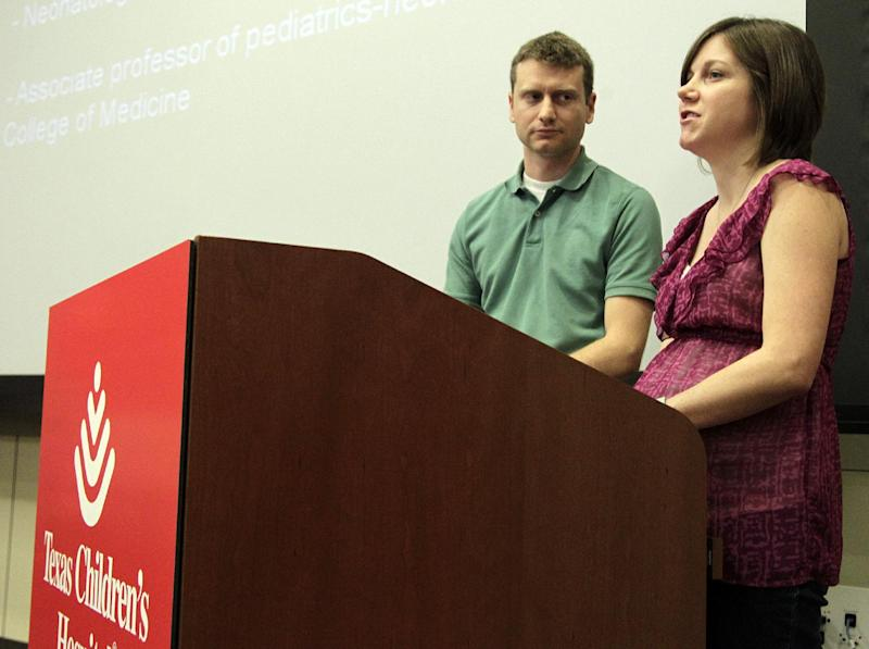 """David and Lauren Perkins, parents of sextuplets, talk to the media during a news conference held at Texas Children's Hospital Pavilion for Women on Wednesday, May 2, 2012, in Houston. Lauren and David Perkins said their three boys, Andrew, Benjamin and Levi, and two of their girls, Allison and Caroline, are doing well. The third daughter, Leah, had surgery Monday to repair a portion of her bowel, and her parents say she is a """"fighter."""" (AP Photo/Houston Chronicle, Mayra Beltran) MANDATORY CREDIT"""