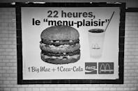 <p>An advertisement for McDonald's 'Menu-Plaisir'—a Big Mac and a Coca-Cola—in a Paris Métro station. The first McDonald's opened in France was in 1972 in the town of Créteil.</p>