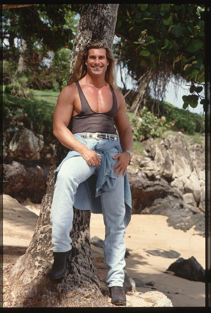 <p>Honestly, when we picture Fabio, he's always flexing. The Italian model struck a pose in a tank top and jeans during a photoshoot in 1993, looking just as we always picture him.</p>