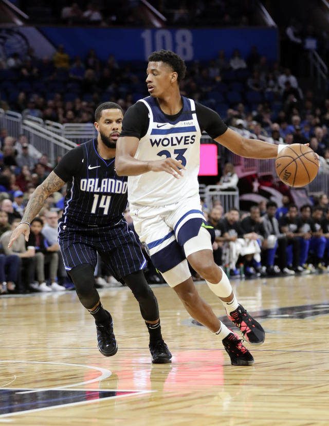Minnesota Timberwolves' Jarrett Culver, right, drives around Orlando Magic guard D.J. Augustin (14) during the first half of an NBA basketball game Friday, Feb. 28, 2020, in Orlando, Fla. (AP Photo/John Raoux)