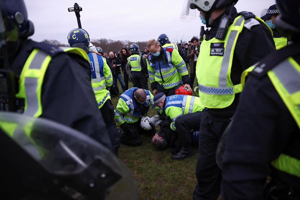 People taking part in an anti-lockdown protest in central London.REUTERS