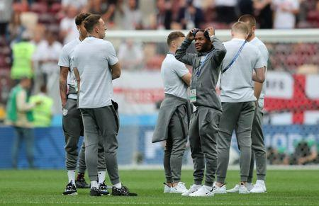 Soccer Football - World Cup - Semi Final - Croatia v England - Luzhniki Stadium, Moscow, Russia - July 11, 2018 England's Raheem Sterling with teammates on the pitch before the match REUTERS/Carl Recine