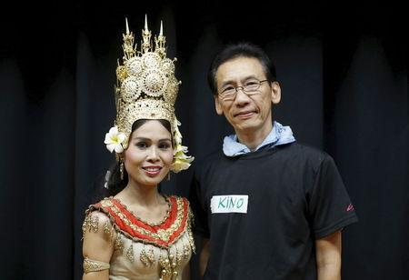 Ky Tu Duong (R), a former Vietnam refugee who now goes by his Japanese name Hitoshi Kino, and Cheth Chan Chrisna, a former Cambodian refugee who now goes by her married name Chrisna Ito, pose for pictures during Asia Sports Festa in Yokohama, south of Tokyo, Japan, October 25, 2015. REUTERS/Yuya Shino/Files