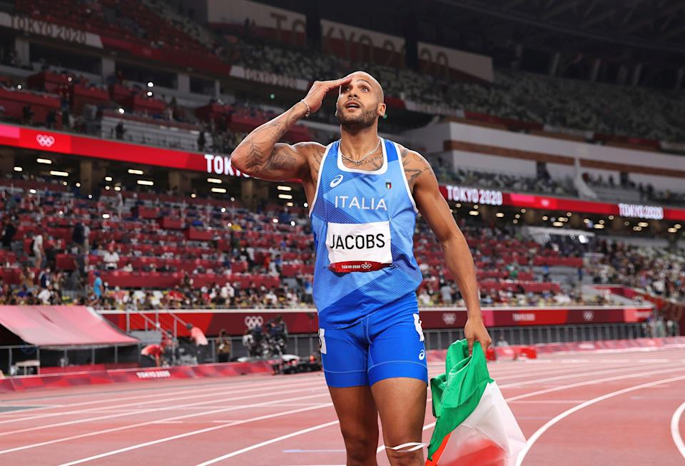 Marcell Jacobs celebrates his 100m triumph on Sunday (AP)