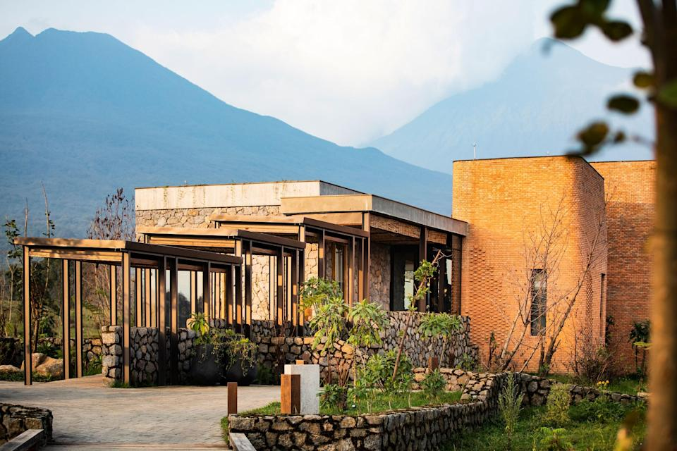 """<p><strong>Set the scene.</strong> Preceded in the area by Wilderness Safaris' tiny <a href=""""https://www.cntraveler.com/hotels/volcanoes-national-park/bisate-lodge?mbid=synd_yahoo_rss"""" rel=""""nofollow noopener"""" target=""""_blank"""" data-ylk=""""slk:Bisate Lodge"""" class=""""link rapid-noclick-resp"""">Bisate Lodge</a>, and more recently One&Only's much larger <a href=""""https://www.cntraveler.com/hotels/ruhengeri/oneandonly-gorillas-nest?mbid=synd_yahoo_rss"""" rel=""""nofollow noopener"""" target=""""_blank"""" data-ylk=""""slk:Gorilla's Nest"""" class=""""link rapid-noclick-resp"""">Gorilla's Nest</a>, Kwitonda is another competitor for those looking for something more close-knit, more intimate. Volcanic-stone pathways meander through lush, flowering meadows and cross rushing streams, linking eight statuesque rooms (villa-sized) to the main lodge. Architecture is boldly scaled, many of the building materials locally sourced—oven-fired red clay bricks, river stones, bamboo and eucalyptus poles. The foundations are steel, rather than concrete, to leave the lightest possible footprint on the land. A sense of mystery pervades, knowing that the mountain gorillas are deep in the mist-shrouded cloud forests of the Volcanoes National Park.</p> <p><strong>What's the backstory?</strong><br> Singita's debut in Rwanda, on the very edge of Volcanoes National Park, makes for a compelling reason to add gorilla-trekking to a classic Serengeti safari. With a well-established network of cleverly curated lodges in the choicest wild places in <a href=""""https://www.cntraveler.com/story/how-to-plan-south-africa-safari?mbid=synd_yahoo_rss"""" rel=""""nofollow noopener"""" target=""""_blank"""" data-ylk=""""slk:South Africa"""" class=""""link rapid-noclick-resp"""">South Africa</a>, Tanzania, and Zimbabwe, Singita has brought its brand of turbo-luxe design and slick, generous hospitality to Rwanda. Gorilla-trekking has suddenly become very comfortable and accessible, and devotees of the brand, who include Ellen DeGeneres, couldn't be more pleased. Sustainably b"""