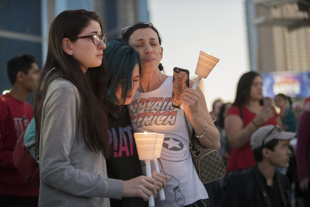 Mourners comfort each other during a candlelight vigil held on the north end of the Las Vegas strip across the street from the SLS hotel and casino on Oct. 2, 2017. (Martin S. Fuentes for HuffPost)