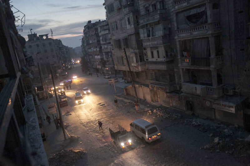 In this Thursday, Nov. 29, 2012 photo, night falls on a Syrian rebel-controlled area as damaged buildings are seen on Sa'ar street after airstrikes argeted the area last week, killing dozens in Aleppo, Syria. (AP Photo/Narciso Contreras)