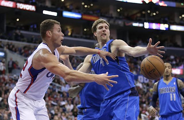 Los Angeles Clippers' Blake Griffin, left, passes the ball around Dallas Mavericks' Dirk Nowitzki, of Germany, during the first half of an NBA basketball game Thursday, April 3, 2014, in Los Angeles. (AP Photo/Jae C. Hong)