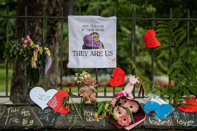 Flowers and tributes are hung on the fence of the Botanic Gardens on March 17, 2019 in Christchurch, New Zealand. 49 people were killed following shooting attacks on two mosques in Christchurch on March 15, 2019. (Carl Court/Getty Images)