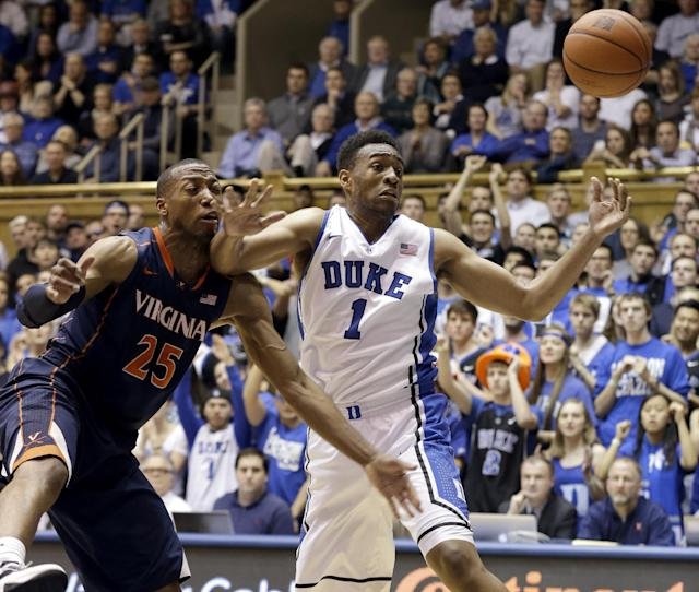 Duke's Jabari Parker (1) and Virginia's Akil Mitchell (25) reach for a rebound during the first half of an NCAA college basketball game in Durham, N.C., Monday, Jan. 13, 2014. (AP Photo/Gerry Broome)