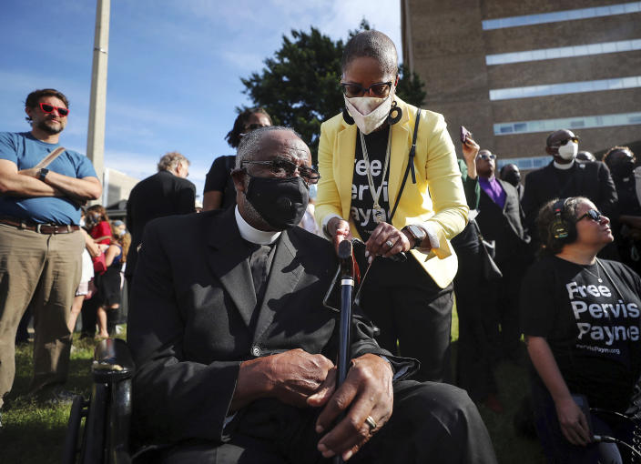 Rolanda Holman attends to her father, Pastor Carl Payne, during a vigil for Pervis Payne outside of the Shelby County Criminal Justice Center on Friday, June 4, 2021 in Memphis. A hearing is scheduled Friday in the case of Payne, a Tennessee death row inmate who has long maintained his innocence and whose lawyers filed a petition saying he is intellectually disabled and should not be executed. (Patrick Lantrip/Daily Memphian via AP)