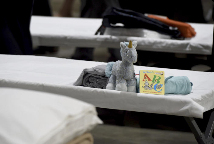 a sleeping area set up inside exhibit hall B of the Long Beach Convention Center, Thursday, April 22, 2021, in Long Beach, Calif., where migrant children found at the U.S.-Mexico border without a parent will be temporarily housed. The beds are in pods of 30. The center is able to house up to 1,000 children and the first children are expected to arrive Thursday afternoon. (Brittany Murray/The Orange County Register via AP, Pool)