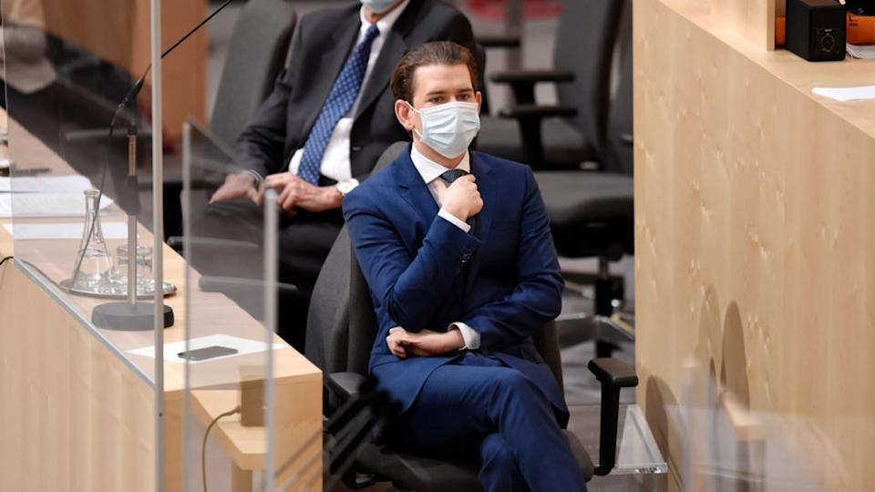 Austrian Chancellor Sebastian Kurz, pictured in parliament, has said easing restrictions may need to be reversed