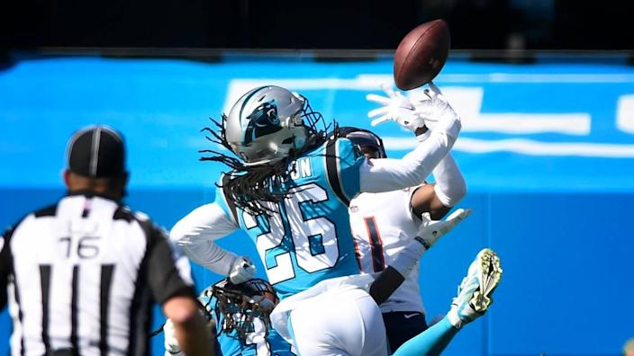 Carolina Panthers cornerback Donte Jackson (26) battles for the ball against Chicago Bears wide receiver Darnell Mooney (11) in first half action Sunday, Oct. 18, 2020.