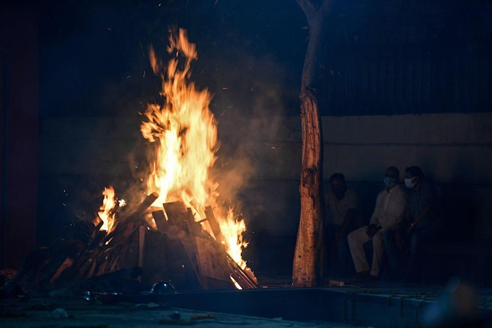 <p>Representational photo. An Indian 'war hero' and his wife were cremated on the same pyre after they died of Covid-19 complications within hours of each other.  </p> (Photo by TAUSEEF MUSTAFA/AFP via Getty Images)