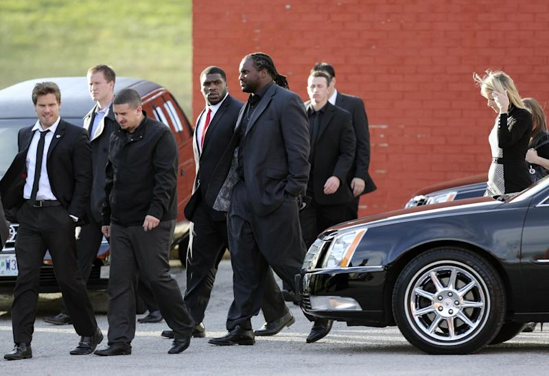 Kansas City Chiefs players and friends leave a memorial service for Jovan Belcher at the Landmark International Deliverance and Worship Center, Wednesday, Dec. 5, 2012, in Kansas City, Mo. Belcher shot his girlfriend, Kasandra Perkins, at their home Saturday morning before driving to Arrowhead Stadium and turning the gun on himself. (AP Photo/Ed Zurga)