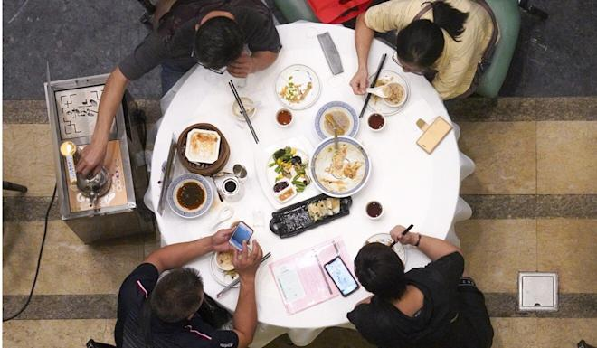 Under current social-distancing rules, no more than four diners are to be seated at the same table. Photo: Winson Wong