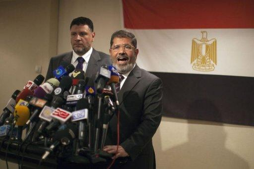 Muslim Brotherhood Egyptian presidential candidate Mohammed Mursi (R) gives a press conference in Cairo. The Muslim Brotherhood today urged Egyptians to rally behind their presidential candidate in an almost certain run-off with rival Ahmed Shafiq, warning the country would be in danger if fallen dictator Hosni Mubarak's premier wins