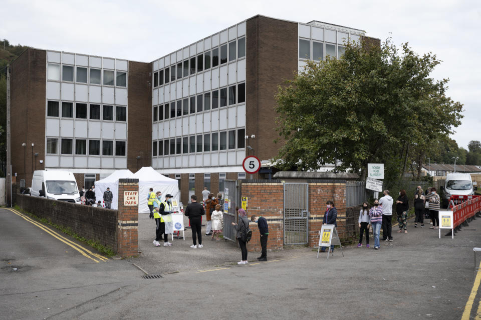 PORTH, WALES - SEPTEMBER 10: A general view of a temporary coronavirus testing centre at the Oldway House Car Park on September 10, 2020 in Porth, Wales. A temporary walk-in testing centre has opened in Porth following a cluster of cases in the lower Rhondda area. There are fears that a local lockdown might be introduced should numbers continue to rise. The first local lockdown in Wales was brought in earlier this week in the county of Caerphilly. (Photo by Matthew Horwood/Getty Images)
