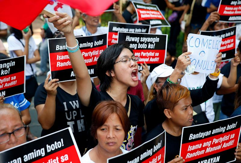 Protesters shout slogans during a rally urging the official poll body to be transparent on the results of the automated May 13 midterm elections Friday, May 17, 2019, in suburban Pasay city south of Manila, Philippines. Unofficial results Friday show most of the senatorial candidates who were endorsed by President Rodrigo Duterte are winning. (AP Photo/Bullit Marquez)