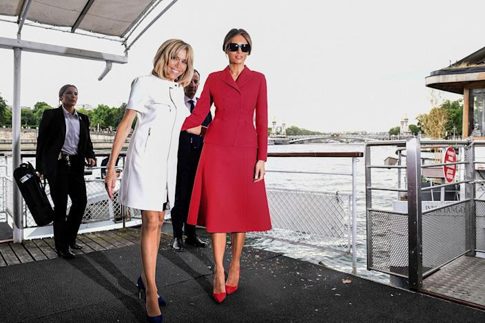 <p>First Lady Melania Trump, right, and French president's wife Brigitte Macron leave after a boat trip down the River Seine in Paris, Thursday, July 13, 2017. (Photo: Martin Bureau/Pool Photo via AP) </p>