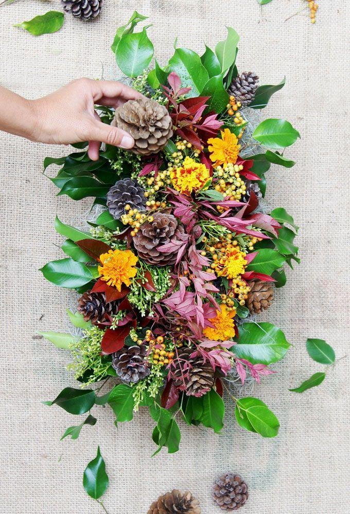 "<p>To keep with the au naturel theme, head straight to your backyard to pull together materials to make this colorful display. </p><p><em><a href=""https://www.apieceofrainbow.com/diy-fall-thanksgiving-centerpiece/"" rel=""nofollow noopener"" target=""_blank"" data-ylk=""slk:Get the tutorial at A Piece of Rainbow »"" class=""link rapid-noclick-resp"">Get the tutorial at A Piece of Rainbow »</a></em></p>"