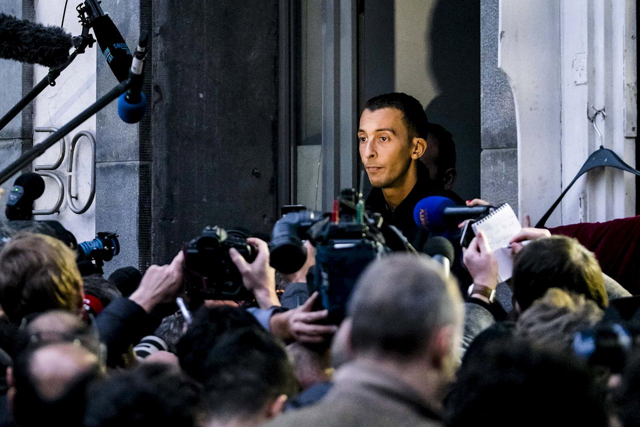 Mohamed Abdeslam, brother of Ibrahim Abdeslam, an attacker who died in the Paris assault, addresses the journalists during an investigation linked to the deadly attacks in Paris, in the Brussels suburb of Molenbeek, November 16, 2015. REUTERS/Benoit De Freine BELGIUM OUT. NO COMMERCIAL OR EDITORIAL SALES IN BELGIUM. FOR EDITORIAL USE ONLY. NO RESALES. NO ARCHIVE.       TPX IMAGES OF THE DAY