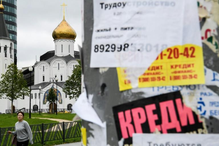 Loan ads are plastered on pillars in downtown Moscow (AFP Photo/Kirill KUDRYAVTSEV)