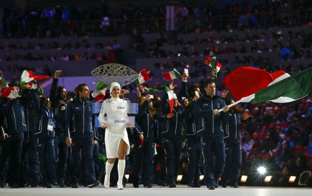 Italy's flag-bearer Armin Zoeggler leads his country's contingent during the opening ceremony of the 2014 Sochi Winter Olympic Games at Fisht stadium February 7, 2014. REUTERS/Brian Snyder (RUSSIA - Tags: OLYMPICS SPORT)