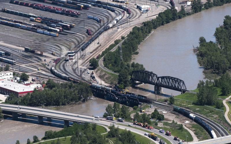 <p> Crews work at the scene of a rail bridge collapse and railcars derailment over the Bow River, southeast of downtown Calgary, Canada on Thursday, June 27, 2013. (AP Photo/The Canadian Press, Larry MacDougal)