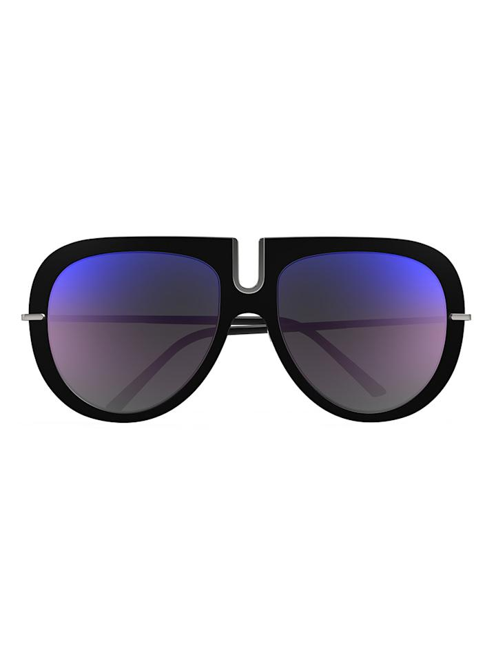 """<p>Silhouette, the eyewear brand popularized by music legends Elton John and John Lennon in the '70s, is bringing back its """"Futura"""" glasses with a fun, modern update featuring the same oversize goggle-style frames in new sleek colorways.</p> <p>For its return, Silhouette commissioned Bergdorf Goodman's artist-in-residence, Ashley Longshore, to paint the glasses on iconic cultural figures. The campaign brings the past and present together for a colorful exploration of the brand's history.</p> <p><strong>Buy It!</strong> Silhouette Futura Sunglasses, $398; <a href=""""http://thewebster.us/"""">thewebster.us</a></p>"""