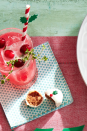 """<p>Keep things light and refreshing with this bubbly gin fizz that has a cranberry twist. </p><p><strong><a href=""""https://www.countryliving.com/food-drinks/a29639548/cranberry-gin-fizz-recipe/"""" rel=""""nofollow noopener"""" target=""""_blank"""" data-ylk=""""slk:Get the recipe"""" class=""""link rapid-noclick-resp"""">Get the recipe</a>.</strong> </p>"""