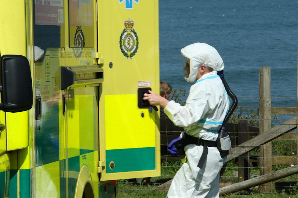 Paramedics rushed to the scene after reports that a woman had got into difficulty in the sea.  (SWNS)