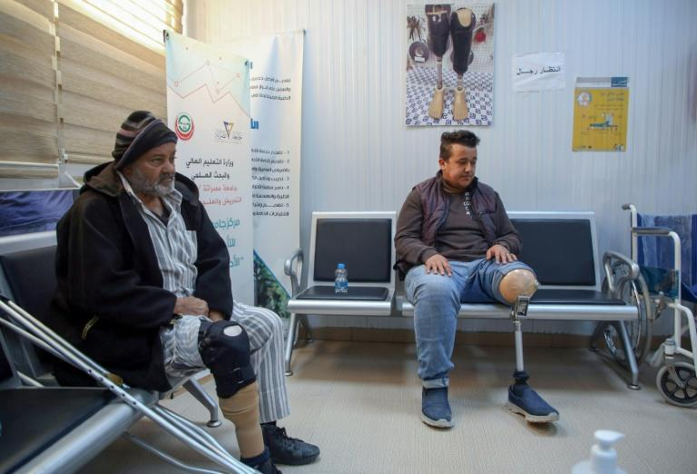 Patients wait for a consultation at a centre for artificial limbs in the Libyan port city of Misrata