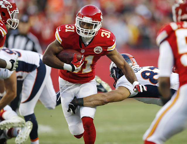 Kansas City Chiefs cornerback Marcus Cooper (31) runs after intercepting a pass during the first half of an NFL football game against the Denver Broncos, Sunday, Dec. 1, 2013, in Kansas City, Mo. (AP Photo/Orlin Wagner)