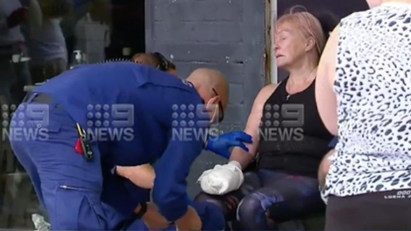 A woman is being treated by paramedics after a dog attack in cronulla