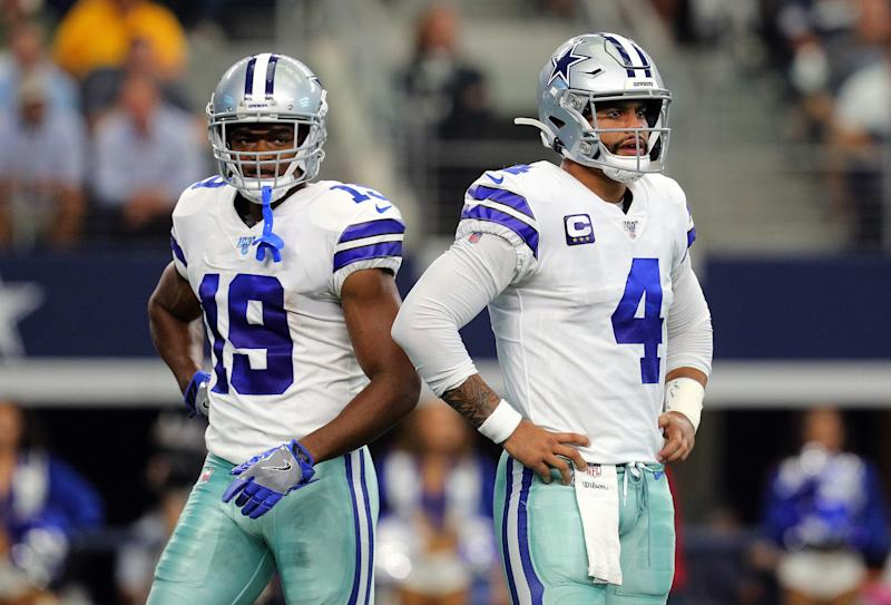 ARLINGTON, TEXAS - OCTOBER 06: Amari Cooper #19 and Dak Prescott #4 of the Dallas Cowboys stand on the field in the first quarter against the Green Bay Packers at AT&T Stadium on October 06, 2019 in Arlington, Texas. (Photo by Richard Rodriguez/Getty Images)