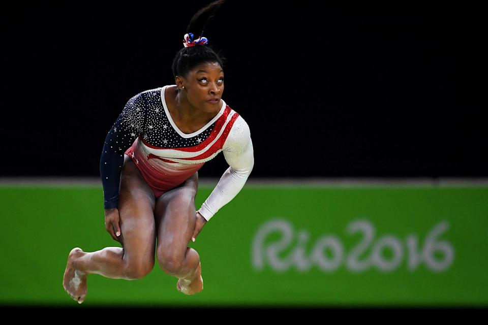 <p>Simone Biles of the United States competes on the balance beam during the Artistic Gymnastics Women's Team Final on Day 4 of the Rio 2016 Olympic Games at the Rio Olympic Arena on August 9, 2016 in Rio de Janeiro, Brazil. (Photo by David Ramos/Getty Images) </p>