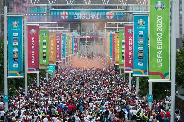 LONDON, UNITED KINGDOM - JULY 11, 2021: Football fans arrive at Wembley Stadium ahead of England match against Italy in the final of Euro 2020 Championship on July 11, 2021 in London, England. The capacity for the final at Wembley has been increased to 65,000 fans making it the biggest crowd at an event in the UK since the outbreak of Covid-19 pandemic as England national team reaches its first tournament final since the 1966 World Cup. (Photo credit should read Wiktor Szymanowicz/Barcroft Media via Getty Images) (Photo: Barcroft Media via Getty Images)