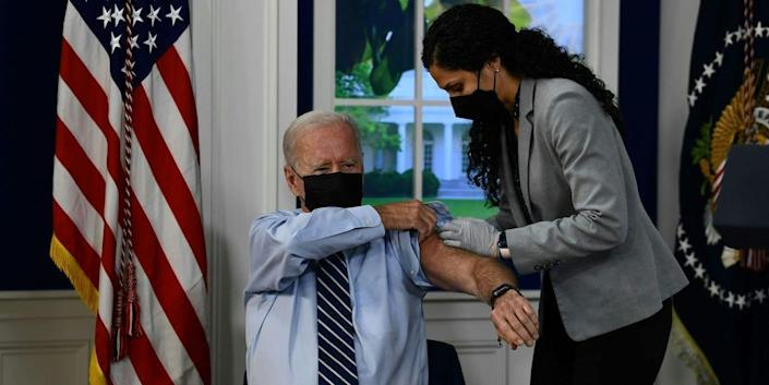 US President Joe Biden receives a third shot of the Pfizer Covid-19 vaccine as a booster on the White House campus September 27, 2021, in Washington, DC.