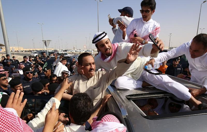 Supporters of Kuwaiti opposition leader Mussallam al-Barrak (centre) celebrate his release on April 21, 2017