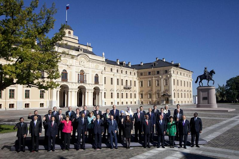 Russia's President Vladimir Putin, center foreground, stands with G-20 leaders during a group photo outside of the Konstantin Palace in St. Petersburg, Russia on Friday, Sept. 6, 2013. World leaders are discussing Syria's civil war at the summit but look no closer to agreeing on international military intervention to stop it.(AP Photo/Pablo Martinez Monsivais)