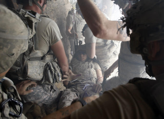 <p>A U.S. soldier, wounded by sniper fire, is evacuated by his comrades in the village of Bargematal, Nuristan province, Aug. 25, 2009. (Photo: Oleg Popov/Reuters) </p>