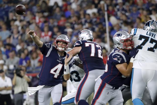 New England Patriots quarterback Jarrett Stidham (4) passes against the Carolina Panthers in the first half of an NFL preseason football game, Thursday, Aug. 22, 2019, in Foxborough, Mass. (AP Photo/Elise Amendola)