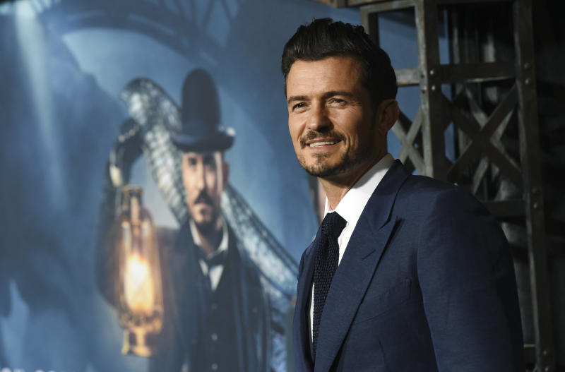 "Orlando Bloom, a cast member in the Amazon Prime Video series ""Carnival Row,"" poses at the premiere of the series at the TCL Chinese Theatre, Wednesday, Aug. 21, 2019, in Los Angeles. (Photo by Chris Pizzello/Invision/AP)"