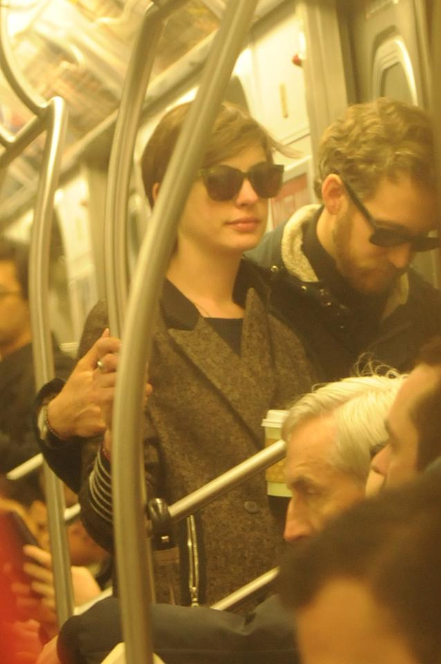 EXCLUSIVE: Anne Hathaway and Adam Shulman take the train in NYC.